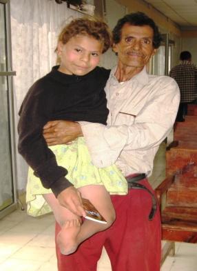 Grandpa carries Quduriape before PET